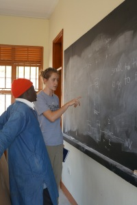 Lauren explains to Albert the flow of electricity from the panels to the batteries