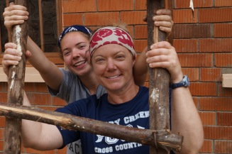 Abbie and Amy Weeks hold the ladder